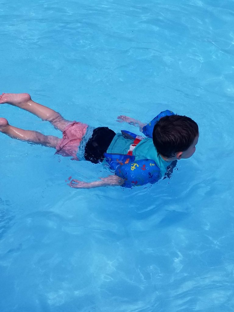 How to help a scared child learn to swim